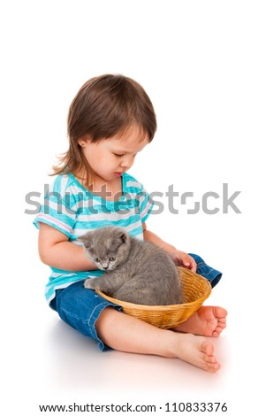 Little girl with a kitten