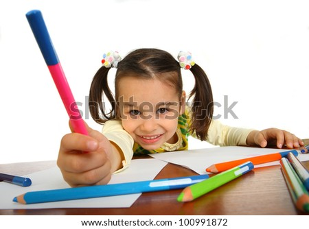 little girl with a pencil next to a white background - stock photo