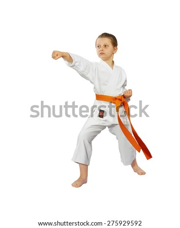 Little girl with a red belt makes punch