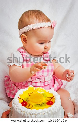 Little girl with a sweet cake in his hands