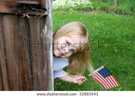 little girl with american flag - stock photo