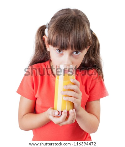 Little girl with an appetite drinking orange juice