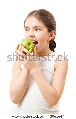 Little girl with apple - stock photo