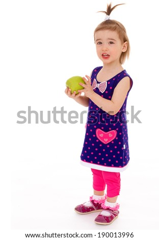 little girl with apple.Isolated on white background. - stock photo
