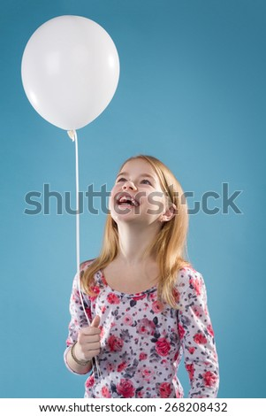 Little Girl With Ballon On Blue Background - stock photo