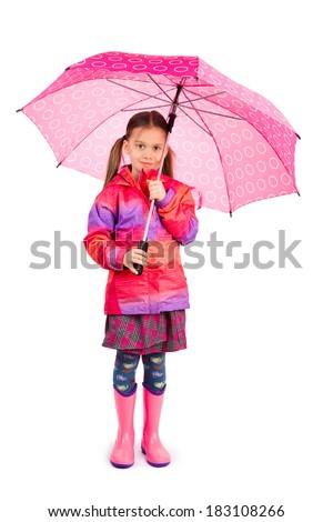 Little girl with big pink umbrela - stock photo