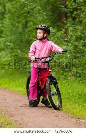 Little girl with bike - stock photo