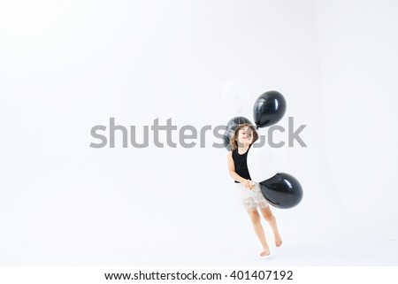 little girl with black air balloon