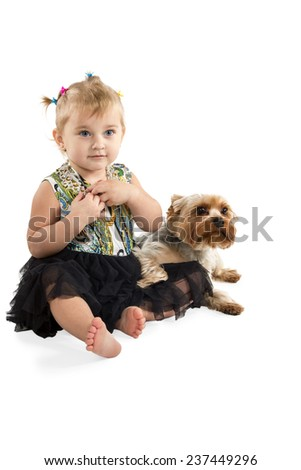 Little girl with blue eyes sitting on the floor with the dog isolated on a white background - stock photo