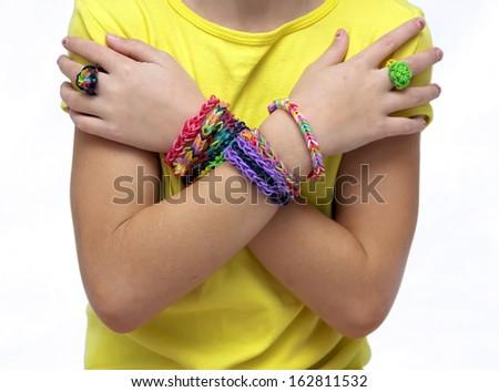 Little girl with bracelets - stock photo