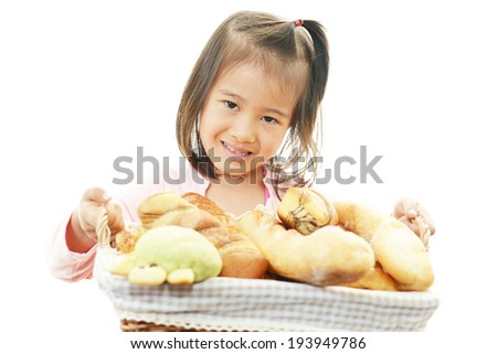 Little girl with breads - stock photo