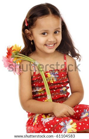 Little girl with bunch of gerbera flowers - stock photo