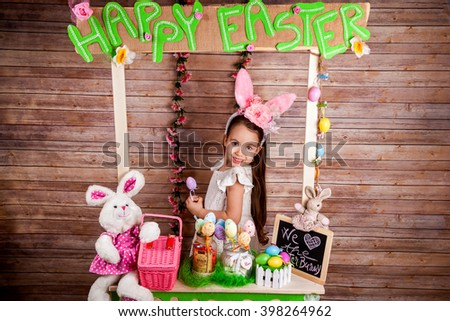 Little girl with bunny ears enjoying the Easter holidays