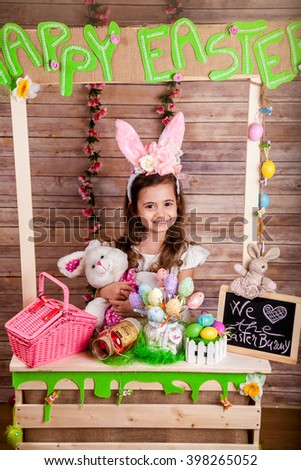 Little girl with bunny ears enjoying the Easter holidays - stock photo