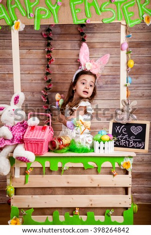 Little girl with bunny ears enjoying the Easter holidayss - stock photo