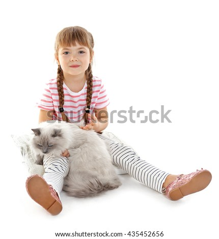 Little girl with cat isolated on white