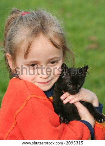 Little girl with cat kid - stock photo