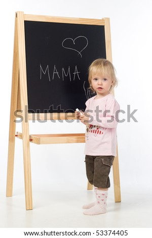 Little girl with chalk in her hands standing near blackboard. Isolating on white