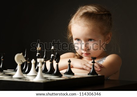little girl with chess - stock photo