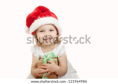 little girl with Christmas cap and a present - stock photo