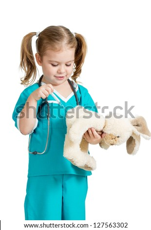 Little girl with clothes of doctor injecting toy isolated on white background