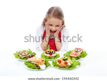Little girl with creative party sandwiches - fresh food creatures, isolated - stock photo