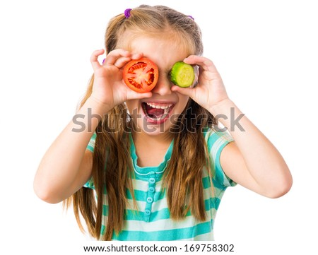 little girl with cucumber and tomato slices around the eyes isolated on white background - stock photo