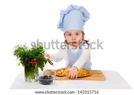 little girl with cutter and pizza