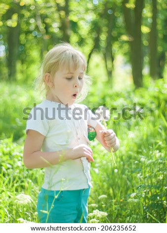 Little girl with dandelion