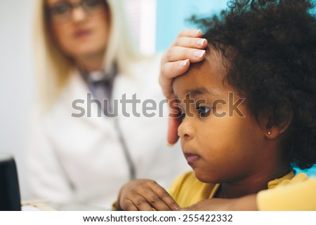 Little girl with doctor. Doctor examining happy girl . - stock photo