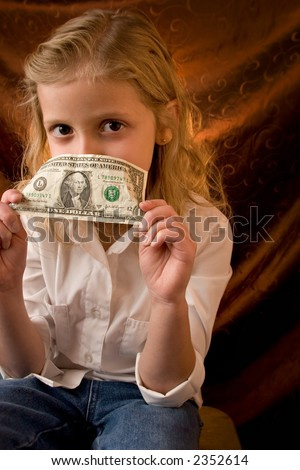 Little girl with dollar - stock photo