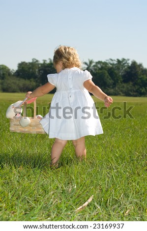 Little Girl with Easter Basket - stock photo