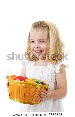 little girl with easter  eggs in a punnet - stock photo