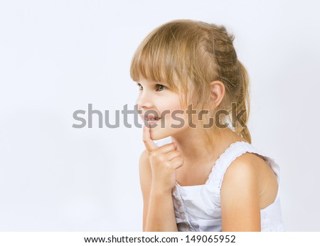 little girl with finger into his mouth, little girl looking with interest (curiosity)  - stock photo