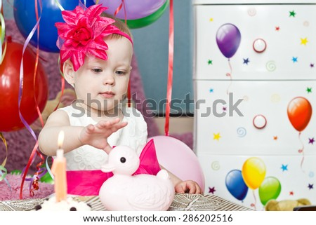 Little girl with first  birthday cake