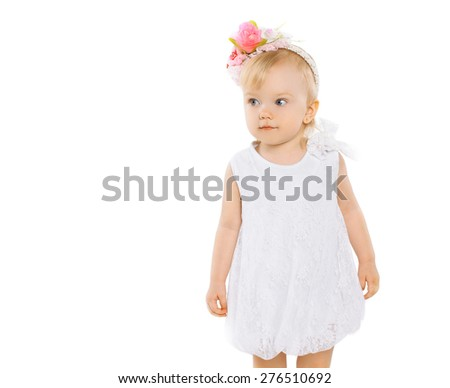 Little girl with floral wreath on head on a white background