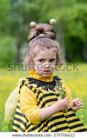 little girl with flowers in hands on outdoors - stock photo