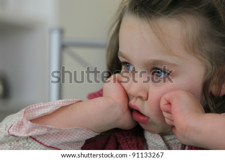Little girl with glassy eyes - stock photo