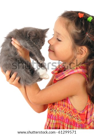 Little girl with gray kitty in hands, isolated on white - stock photo