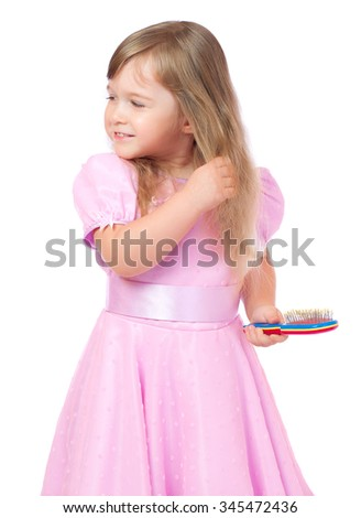 Little girl with hair brush - stock photo