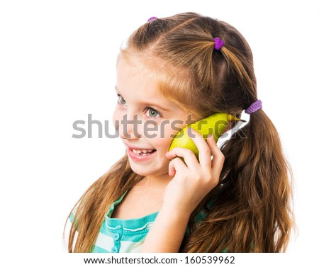 little girl with half pear as mobile phone on a white background - stock photo