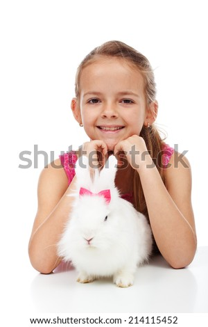 Little girl with her adorable white rabbit - isolated - stock photo