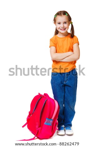 Little girl with her arms crossed, isolated - stock photo