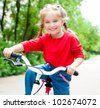 little girl with her bicycle - stock photo