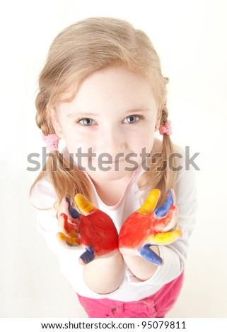 little girl with her hands painted - stock photo