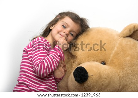 little girl with her teddybear [approx. 6 years old] - stock photo