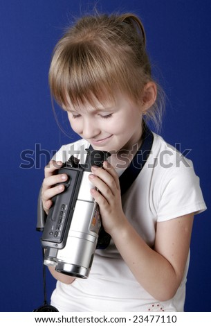 little girl with home video camera