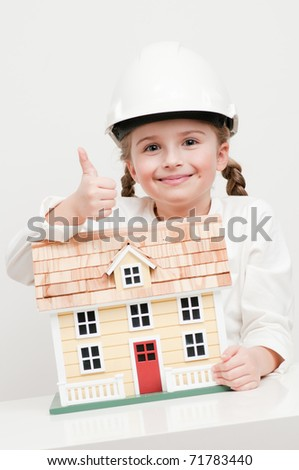 Little girl with house model - stock photo