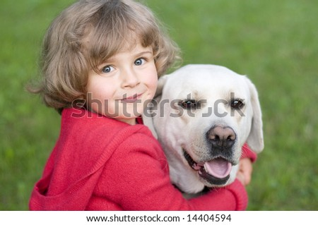 Little girl with Labrador retriever