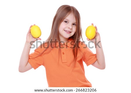 little girl with lemons - stock photo